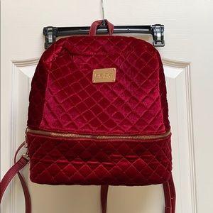 Brand new! Never used red velvet backpack by bebe